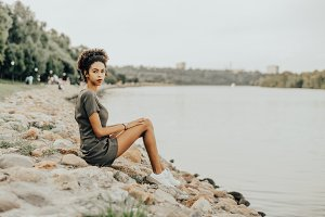 Black girl next to the river