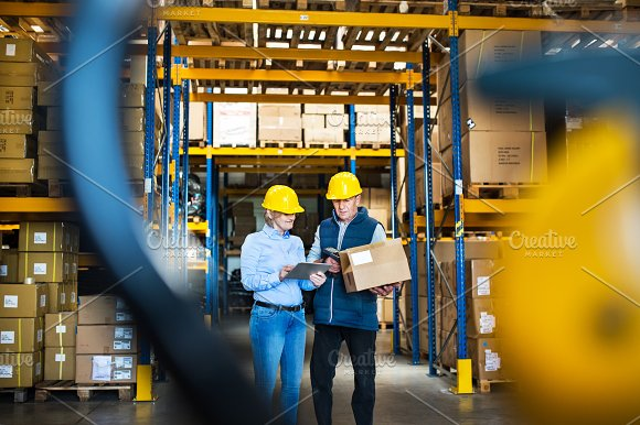 Senior Managers Or Supervisors With Tablet Working In A Warehouse Controlling Stock