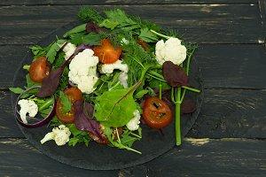 Varied vegetable salad. Multicolored salad.