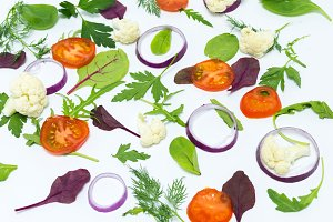 Sliced vegetables on a white background. Scattered vegetables.