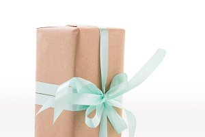 Craft box with a bow. Turquoise ribbon.