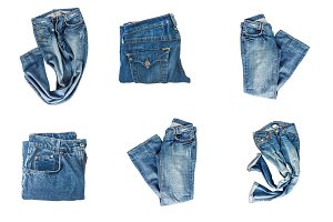 Collection of folded jeans isolated