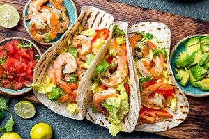 Shrimps tacos with salsa, vegetables and avocado. Mexican food
