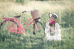 young girl  ride bicycle