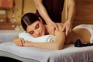Young woman doing massage in spa salon