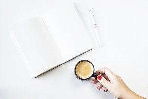 Notepad and coffee. Minimalism