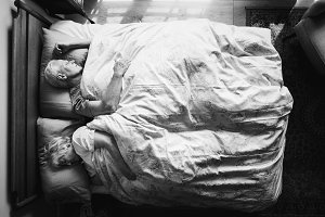 Elderly couple sleeping in a bed