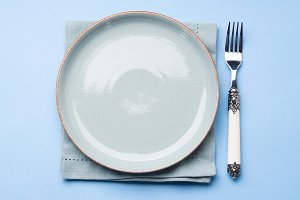 Blue pastel ceramic dish on napkin with fork