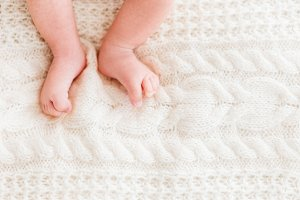 Newborn baby on knitted background