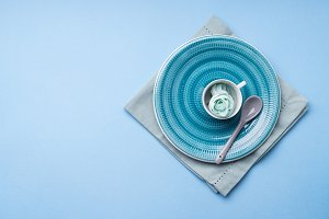 Blue ceramic dish on napkin with flowers