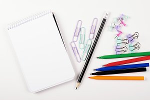 Crayons and stationery. Back to school concept. Mockup.