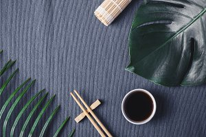 Asian food background. Chopsticks and soy sauce