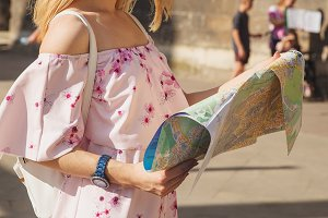 City tourist woman with a map