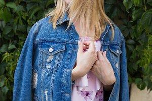 Woman in ragged denim jacket
