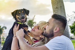 Couple in love with their dog.