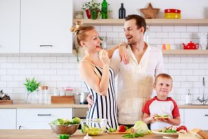 Picture of parents and young son preparing food in kitchen