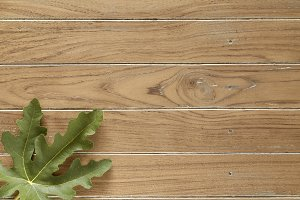 fig leaves on wooden background
