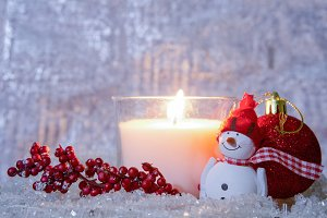 Christmas composition-lighted candle