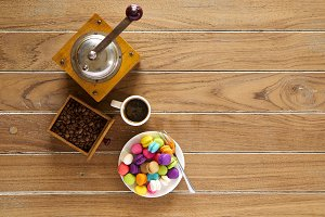 Morning coffee on wooden with macarons biscuit