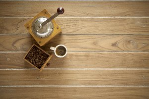 coffee beans and coffee grinder on wooden