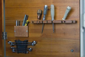 Set of working tools hanging on the shelf