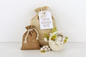 Bags with empty tag mockup, flowers