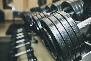 Heavy dumbbells. Sport motivation.