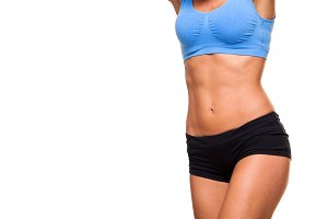 young female body in fitness sports clothing. Athletic woman. isolated on white background. abs