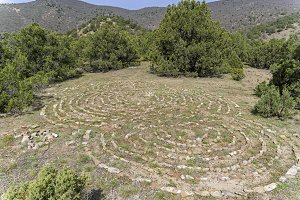 A labyrinth lined with stones.