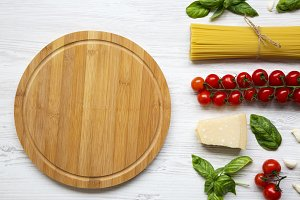 Round wooden board with ingredients