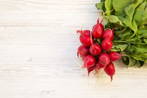 Fresh red radish on white wooden