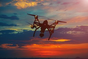 Drone flying over a sunset sky