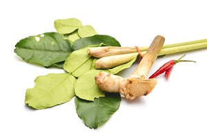 thai spicy soup ingredients with galangal on white background