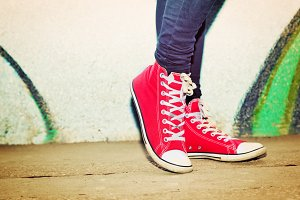 Red sneakers worn by a teenager