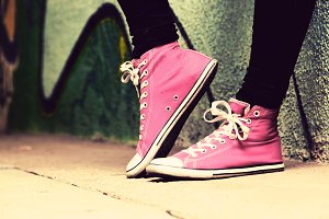 Pink sneakers worn by a teenager