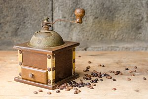 Vintage coffee grinder on rustic bac