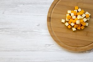 Pieces of mimolette and edam cheeses