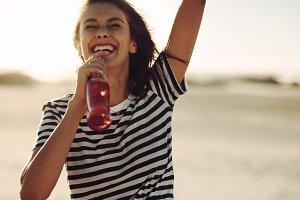 Woman enjoying refreshing drink