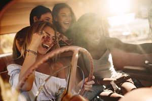Young women enjoying on the road