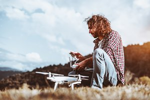 Man with quadcopter outdoors