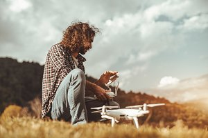 Curly bearded guy with the drone