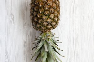 Large ripe pineapple on a white