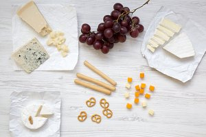 Tasting cheese with grapes, bread