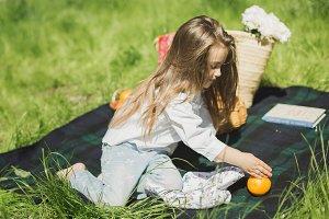 little girl on a summer picnic