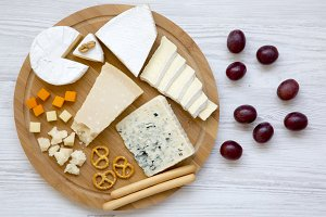 Tasting delicious cheese with grapes