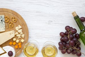 Tasting cheese with wine, grapes