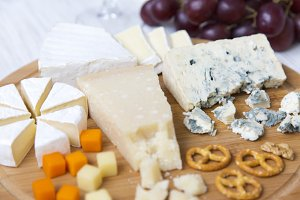 Tasting cheese with wine, grapes,