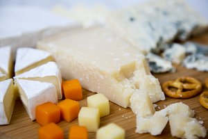Tasty cheese on wooden board.