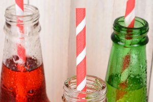 Closeup Bottles With Straws