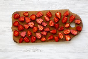 Fresh raw strawberries on wooden